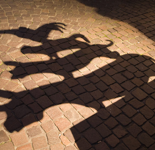 "shadow of the sculpture of the famous town musicians of Bremen. ""The Town Musicians of Bremen"" is a fairy tale from Brothers Grimm."